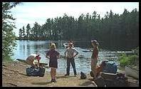 The water taxi leaves Marion, Emily, Ray and Fleur, lots of bags and two canoes in Algonquin Provincial Park, Canada
